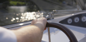 Steering a boat.